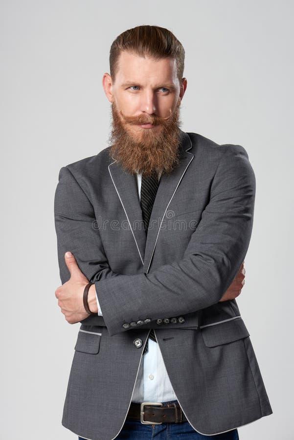 Myślącego modnisia biznesowy mężczyzna zdjęcie stock
