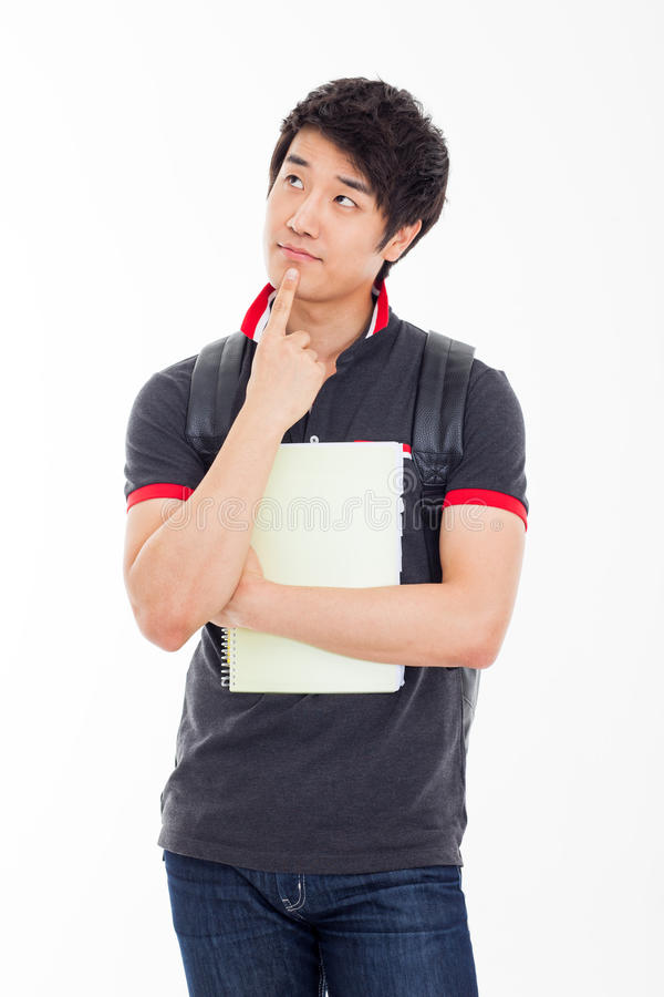 Myślący młody Azjatycki uczeń. obraz stock
