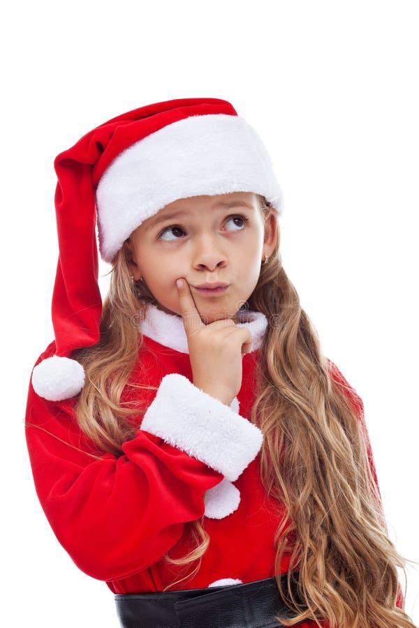 Myśleć Santa - mała dziewczynka w sezonowym stroju fotografia royalty free