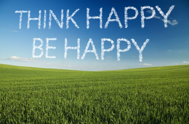 Myśleć szczęśliwy, jest szczęśliwy, pisać w chmurach obraz stock