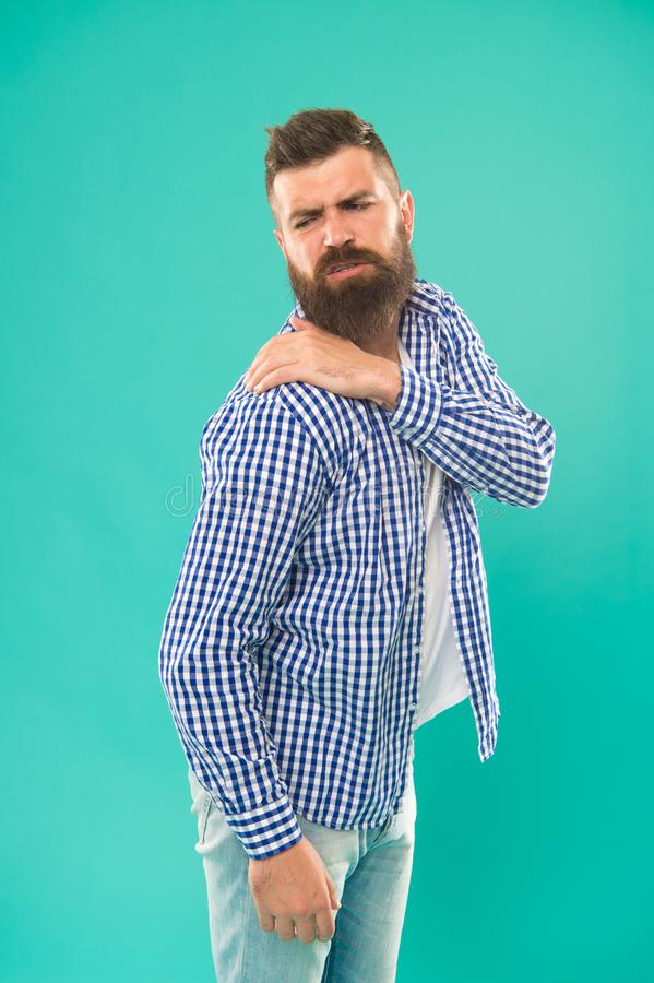My back hurts. Man mature painful face got injured. Problems with health appears suddenly. Man touch back and shoulder royalty free stock photo