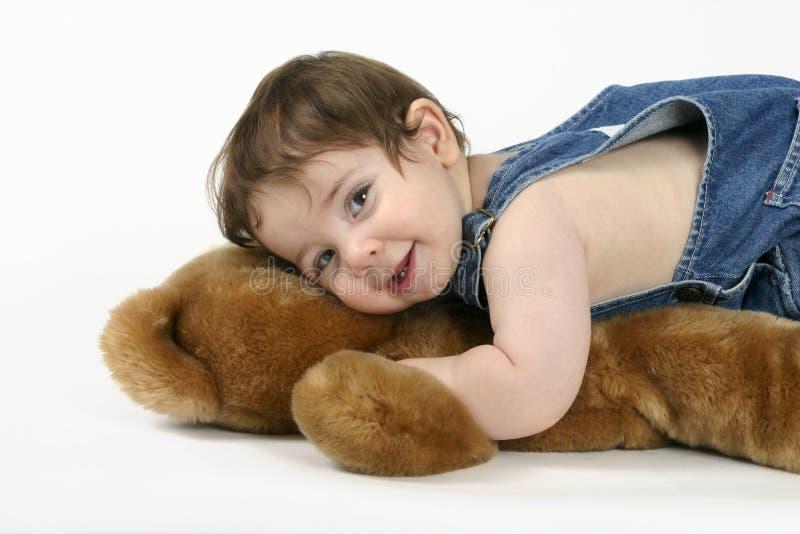 My Best Friend. A beautiful baby cuddles a teddy bear