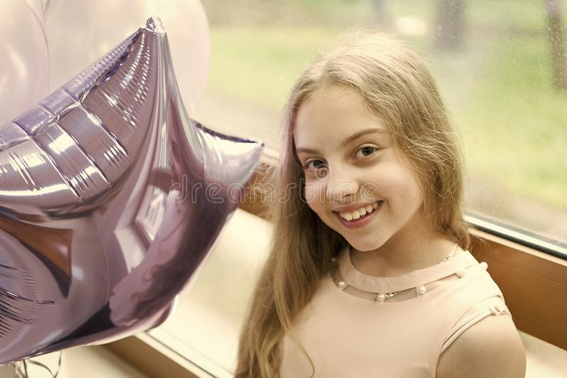 My birthday time has come. Happy cute little girl celebrating birthday with air balloons. Adorable small child enjoying stock photos
