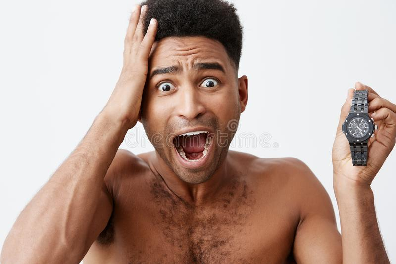 My bus is already in other city. Young good-looking attractive dark-skinned man with afro hairstyle woke up late and. Missed his train to other city. Negative royalty free stock photography