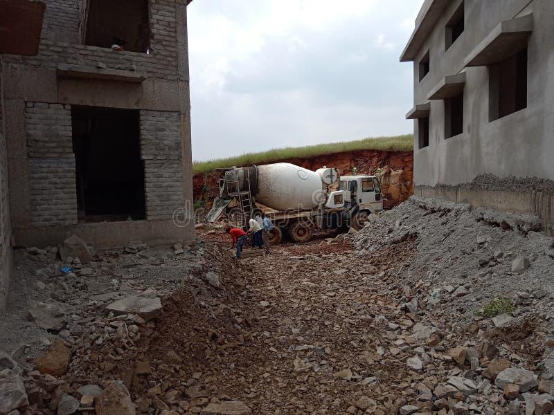In my construction site concrete actually started with transit mixer. In my construction site concrete actually started with transit royalty free stock photos