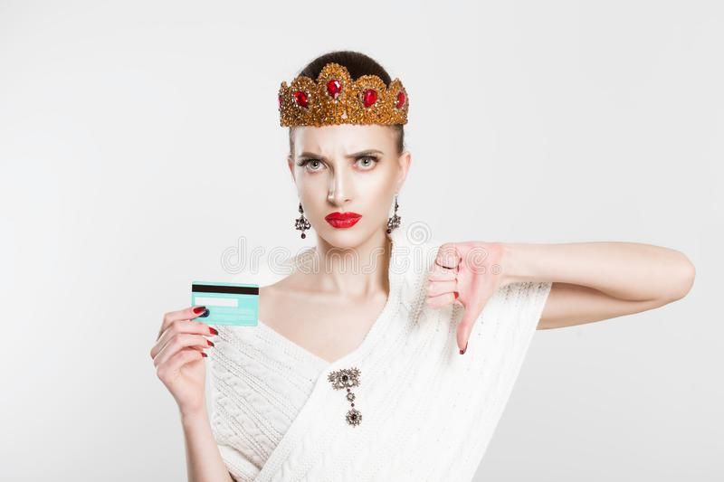 My credit card is blocked.  Retro styled woman thumbs down with blank card isolated on white background stock photos