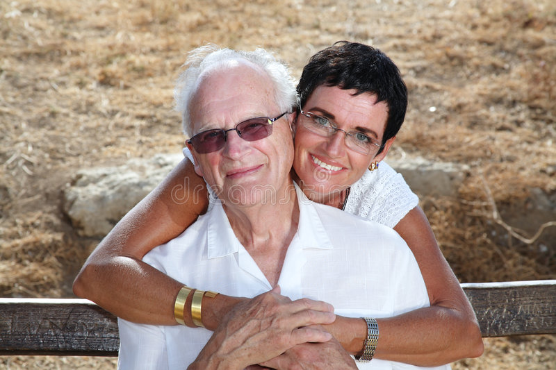 My dad and I. Happy daughter giving her father a hug royalty free stock photo
