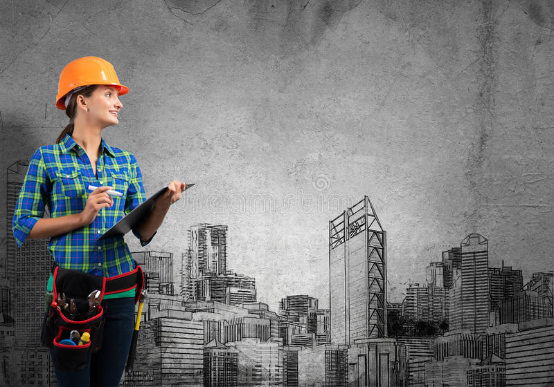 My development plan. Engineer woman with folder and sketches of construction project on wall stock image