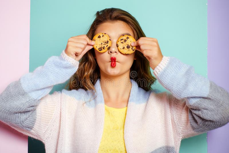 My favorite cookies. Pretty girl covering eyes with cookies. Bakery style chocolate chip cookie recipe. Cute girl having. Fun with cookies. Following a cooking royalty free stock photos