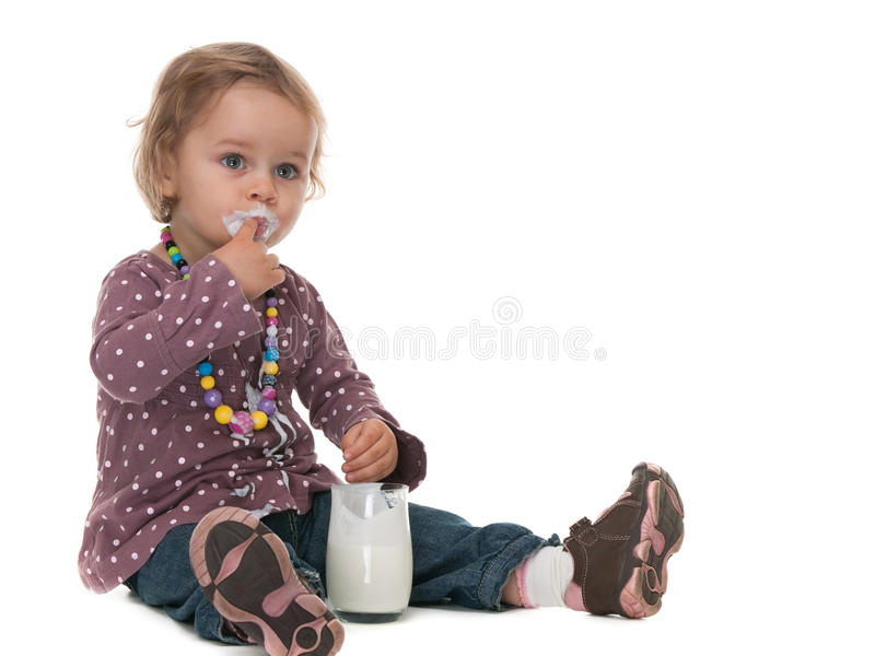 My finger is tastier than milk! stock photography