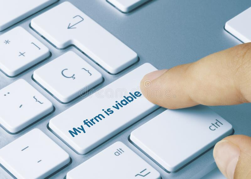 My firm is viable - Inscription on Blue Keyboard Key. My firm is viable Written on Blue Key of Metallic Keyboard. Finger pressing key royalty free stock photo