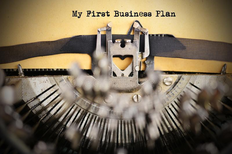 My first business plan text written on beige paper by old typewriter machine royalty free stock photo