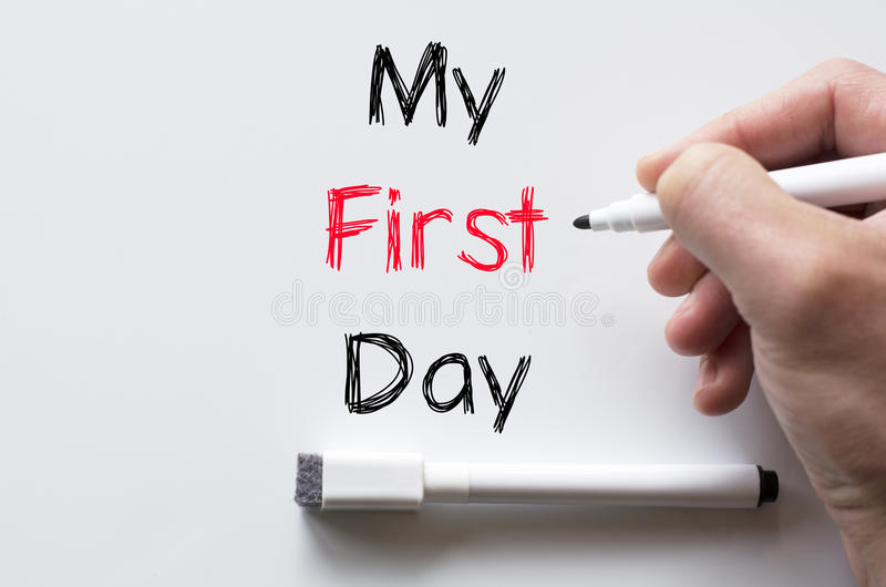 My first day written on whiteboard. Human hand writing my first day on whiteboard stock images