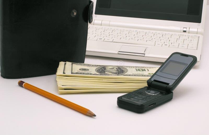 My friends. Notebook, organaizer, mobilphone, pensil ad heap of dollars stock image