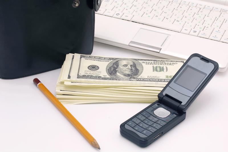 My friends 4. Notebook, organaizer, mobilphone, pensil ad heap of dollars royalty free stock images