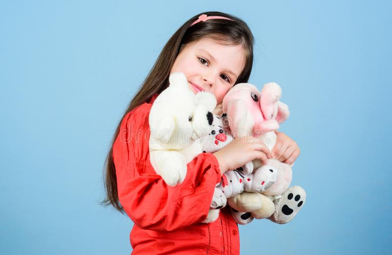 My funny friend. happy childhood. Birthday. little girl playing game in playroom. small girl with soft bear toy. child. Psychology hugging a teddy bear. toy stock photography