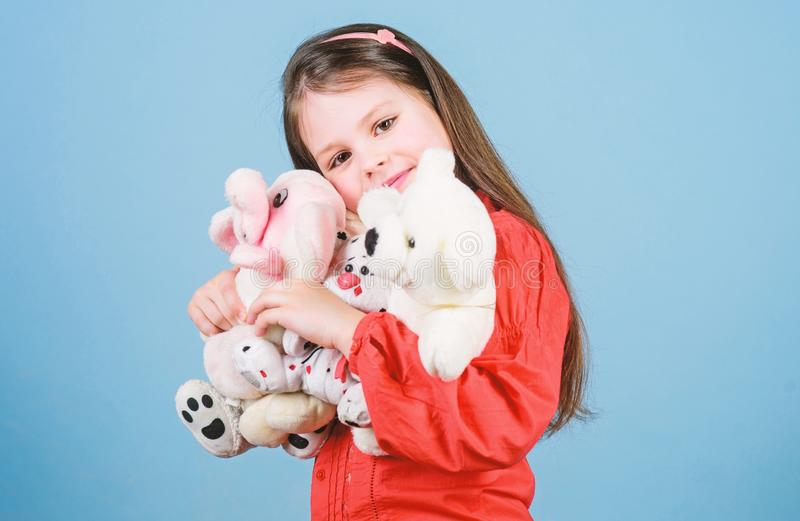 My funny friend. happy childhood. Birthday. little girl playing game in playroom. small girl with soft bear toy. child. Psychology hugging a teddy bear. toy royalty free stock images