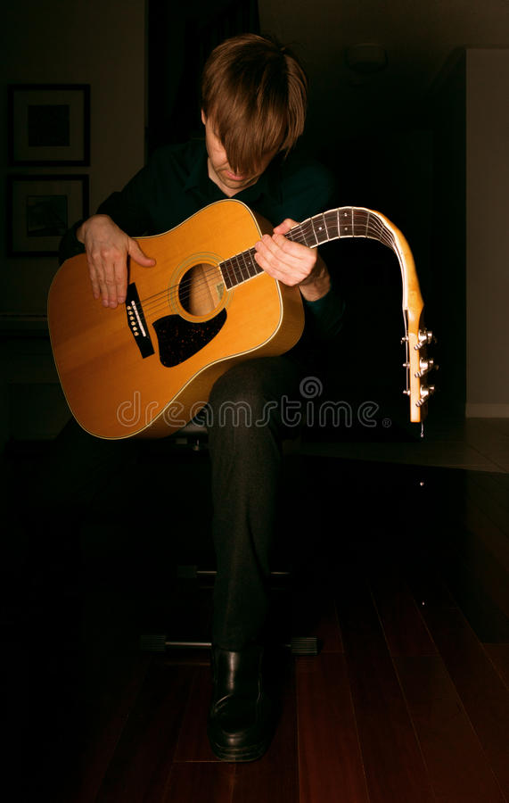 While my guitar gently weeps. A surrealistic photograph: the guitar is crying at the end of a sad song stock photo