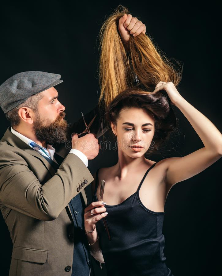 When my hair is long I go to hairdresser. Professional hairdresser and sexy woman. Bearded man ladies hairdresser at. When my hair is long I go to hairdresser royalty free stock photography