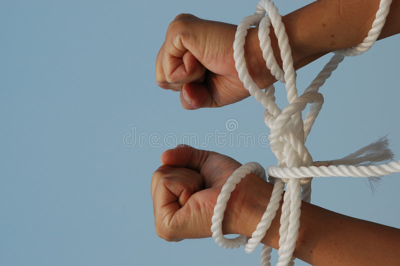 My hands are tied. Pair of hands bound or tied with rope - metaphorical - my hands are tied royalty free stock photo