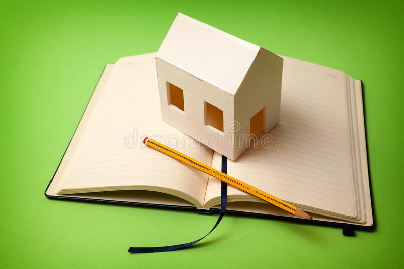 My home plan. Requirements of the house. Paper house on memorandum block stock photos