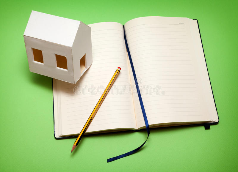 My home plan. Requirements of the house. Paper house on memorandum block stock images