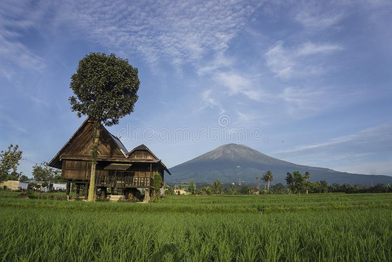 My Hometown. Traditional house of Pagaralam, South Sumatera, with Dempo mountain background royalty free stock photos