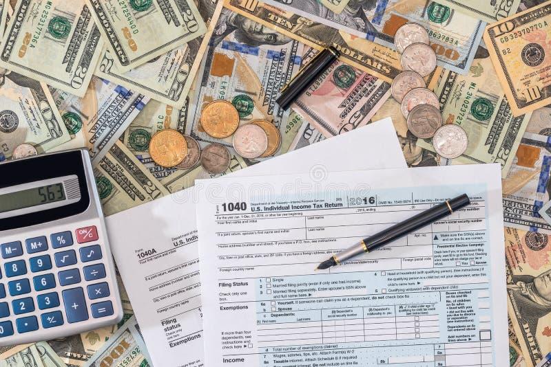 my i my podatek forma pieniądze z kalkulatorem, moneta zdjęcia royalty free