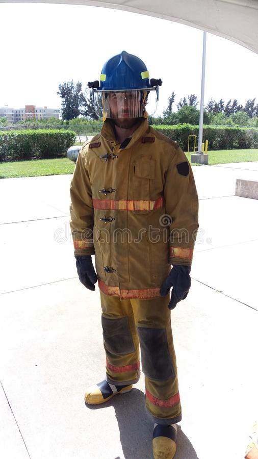My job is extinguish fires. On guard. Firefighter with uniform and helmet. Masculinity and male job. Manly duty. Fireman stock photos
