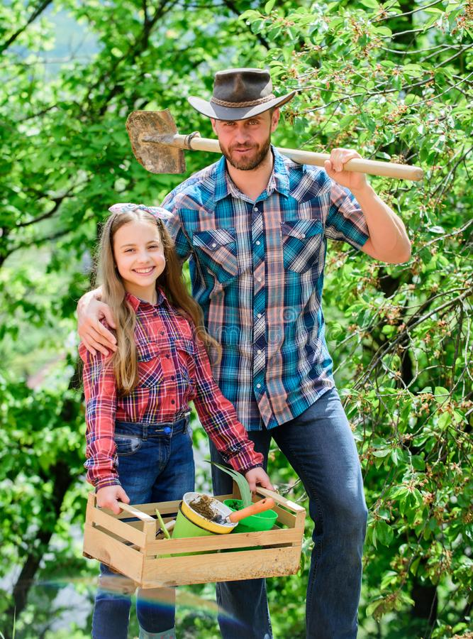 My job is my passion. spring village country. little girl and happy man dad. earth day. new life. ecology environment royalty free stock photography
