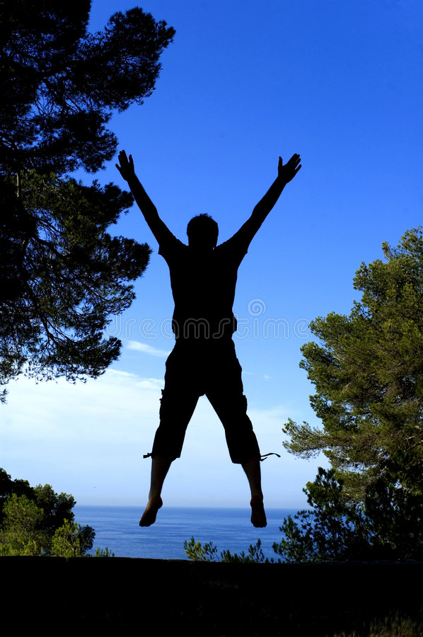 My joy. A man jumping to express his joy stock photo