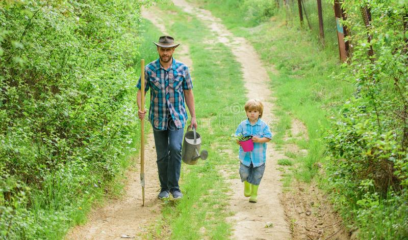 It is my life. happy earth day. Family tree nursering. father and son in cowboy hat on ranch. Eco farm. watering can. Pot and shovel. Garden equipment. small stock photos