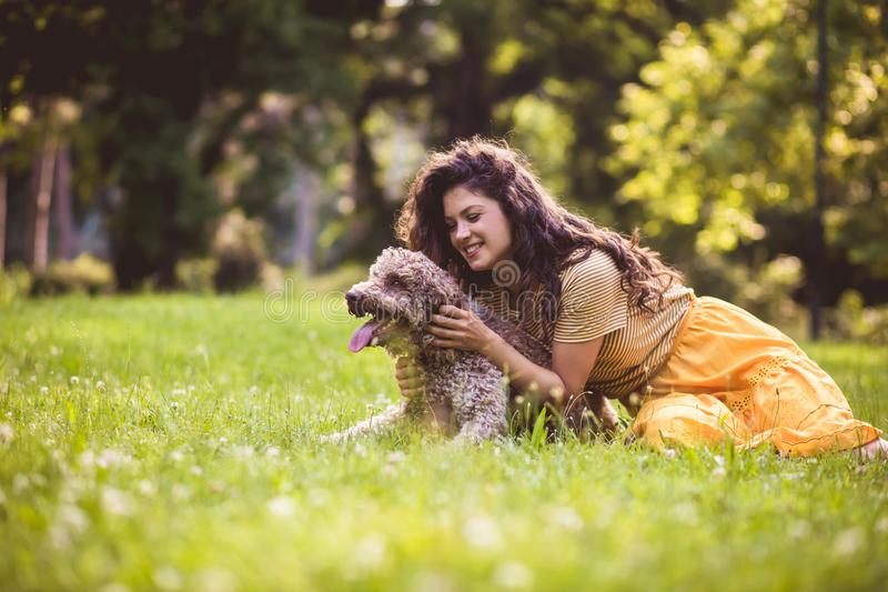 My little friend. Woman in nature with dog royalty free stock images