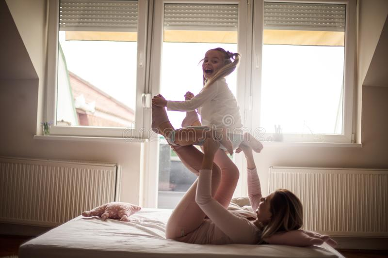 My mom is a strong. Mother and daughter in bed stock photo