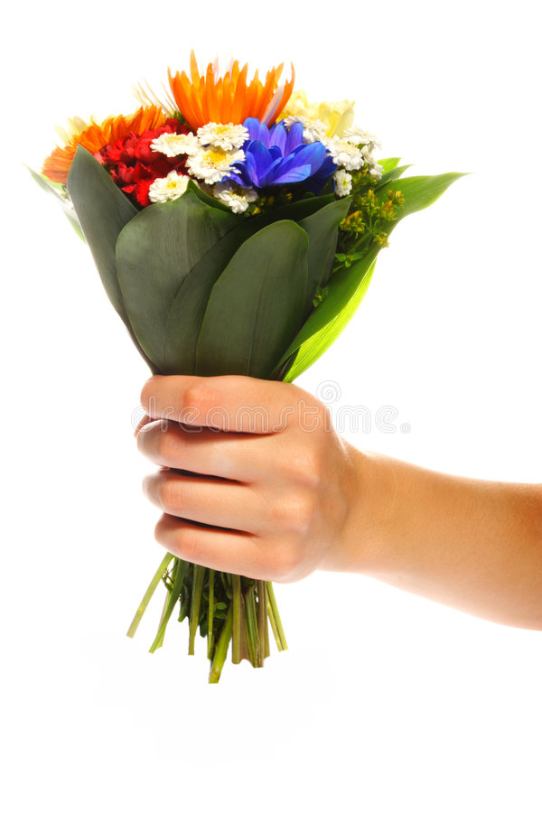 My present for you. Hand holding bunch of various flowers royalty free stock image