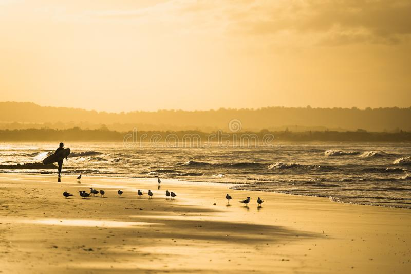 Surfer at Byron Bay. During my road trip along the east coast of Australia i found this beautiful place at byron bay beach. The surfer on this photo let it look royalty free stock photography