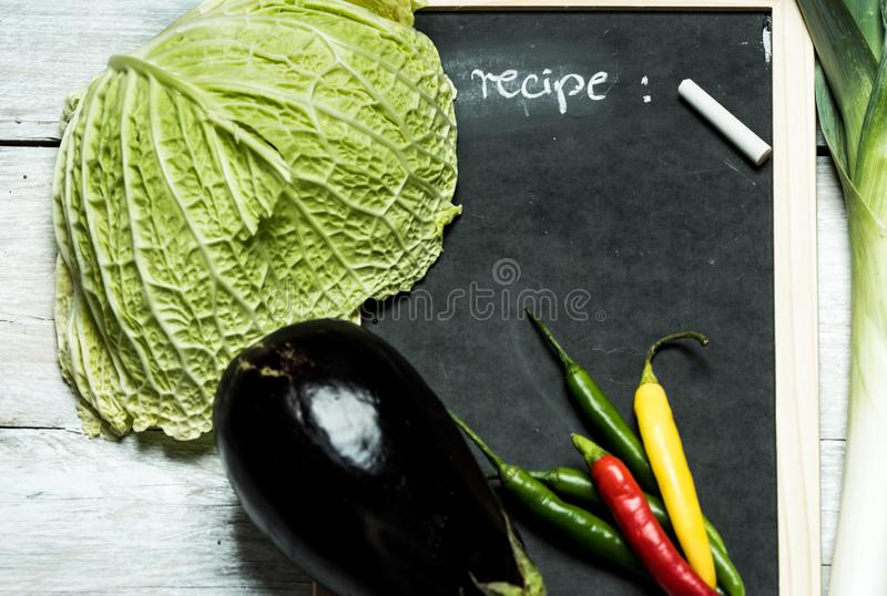 My rustic Kitchen - Blackboard with the word `recipe` and vegetables stock images