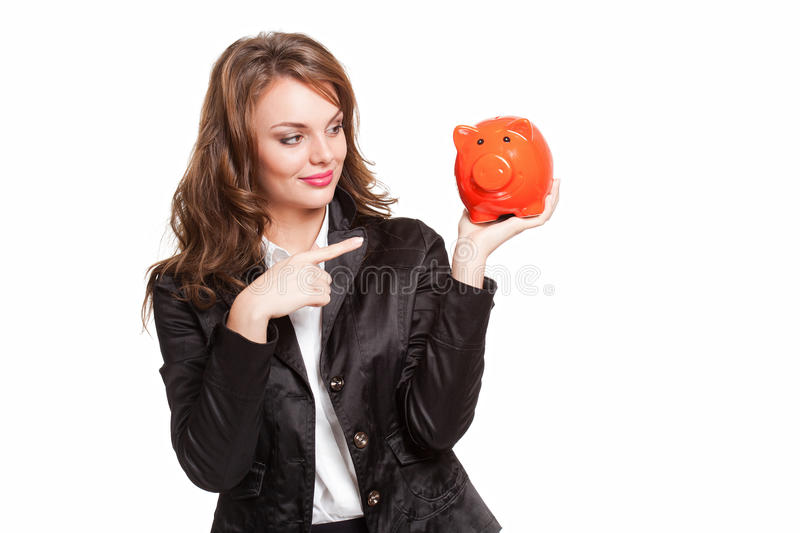 My savings... Portrait of a cool beautiful young fashionable brunette with piggy bank stock photo