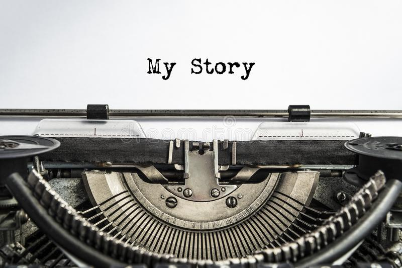 My Story, typed words on a vintage typewriter. Close-up. old paper, life history stock photo