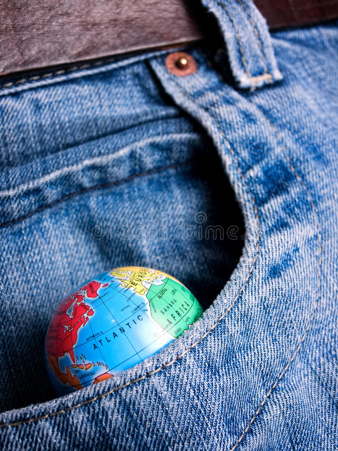 My World. Globe in the pocket as a metaphor about eternal desire about world possession stock photo