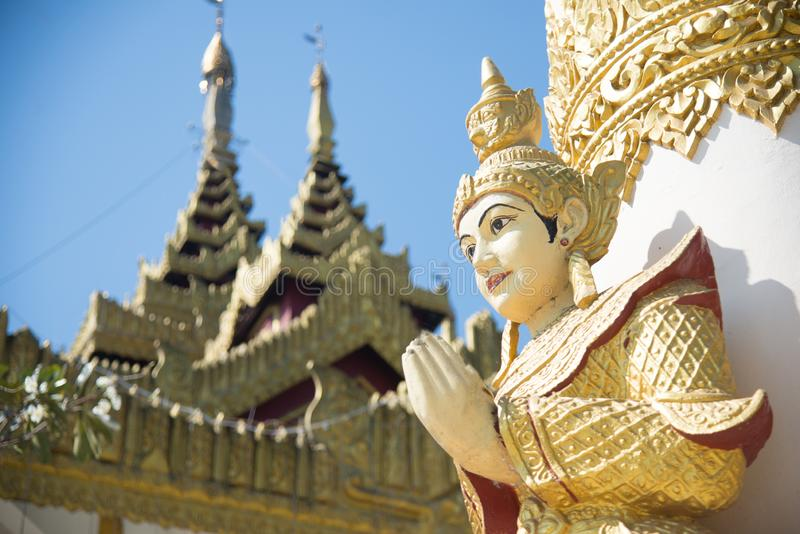 Myanmar angle image press the hands together at the chest in sign of respect for buddha in buddhist temple at yangon city old royalty free stock photo