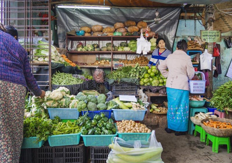 MYANMAR, BAGAN - FEB 3, 2018 : Nyaung U Market Local market sell fresh food vegetable fruit in Bagan Crowd people tourist seller. Shopping landmark royalty free stock image