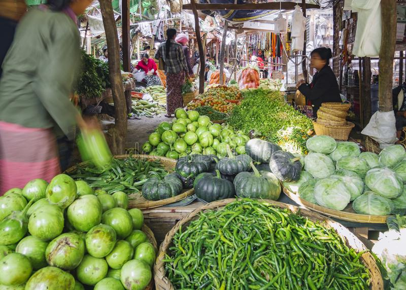 MYANMAR, BAGAN - FEB 3, 2018 : Nyaung U Market Local market sell fresh food vegetable fruit in Bagan Crowd people tourist seller stock photos