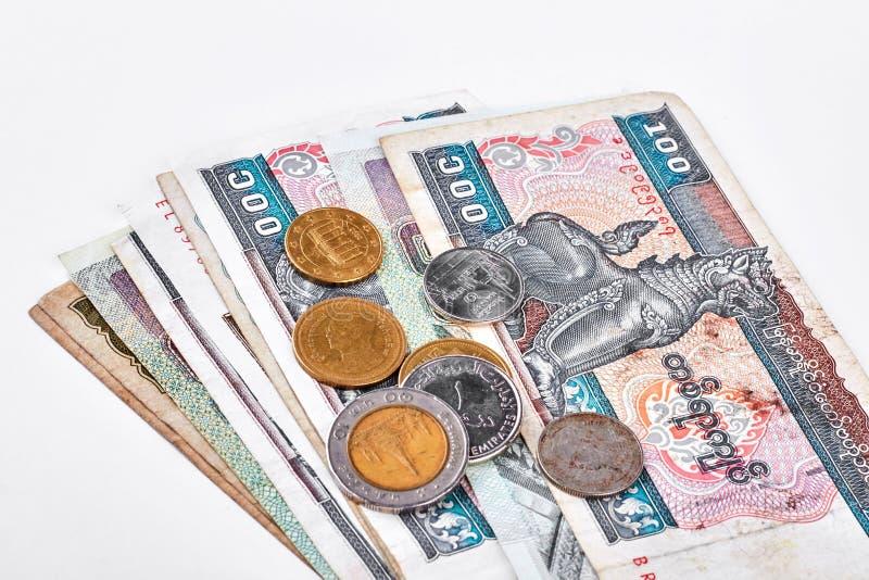 Myanmar burma kyats and coins. Myanmar kyat banknotes and coins on white background. Burmese kyat myanmar money stock photography