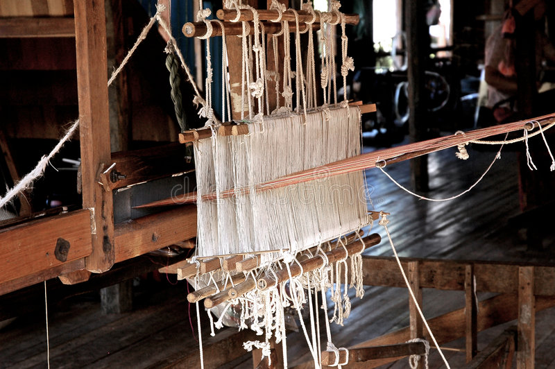 Myanmar, Inle lake: Loom at the silk factory stock photo