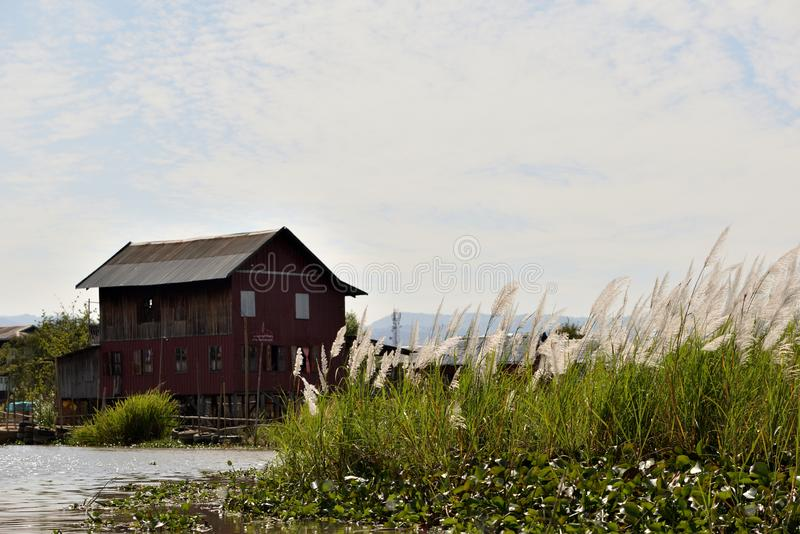 Myanmar Inle lake silver grass floating house royalty free stock photography