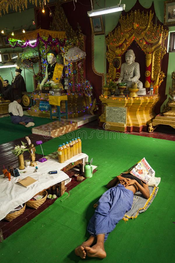 Myanmar - Popa mount. The nat inside the temple and a special pray for a believer stock photo