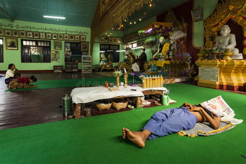 Myanmar - Popa mount. The nat inside the temple and a special pray for a believer royalty free stock photos