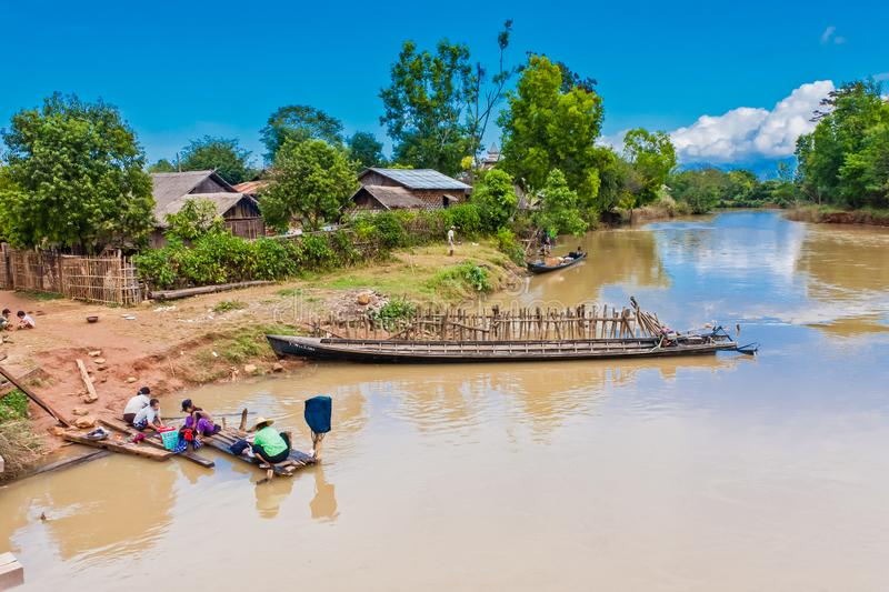 A bathing day for a Burmese family. Myanmar is a very poor country and many people have to wash their body and clothes just in rivers and other open water bodies royalty free stock photography