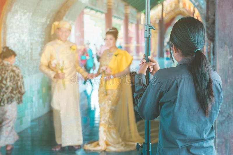 Myanmar wedding photography. A Burmese couple in a tradition dress that was photographed by a wedding photographer and his stock image